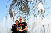 Sania Mirza of India and Bruno Soares of Brazil mixed doubles champions celebrate with the trophy in front of the Unisphere in Flushing Meadows...