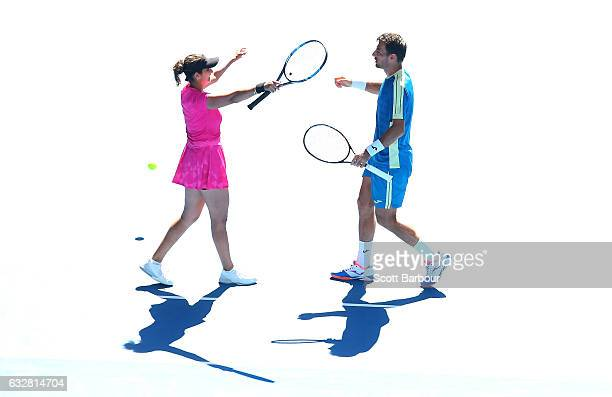 Sania Mirza of India and Ivan Dodig of Croatia celebrate winning against Samantha Stosur and Sam Groth of Australia in their mixed doubles semifinal...