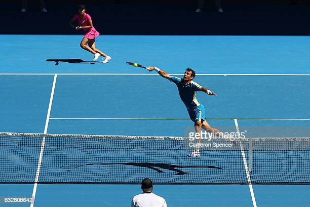 Sania Mirza of India and Ivan Dodig of Croatia compete against Samantha Stosur and Sam Groth of Australia in their mixed doubles semifinal match on...