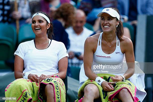 Sania Mirza of India and Martina Hingis of Switzerland celebrate in the Final Of The Ladies' Doubles against Ekaterina Makarova of Russia and Elena...