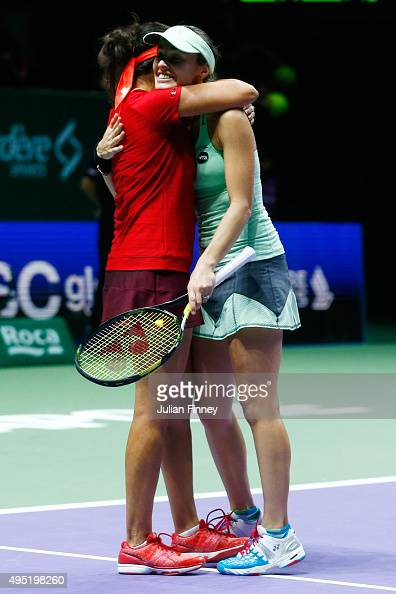 Sania Mirza of India and Martina Hingis of Switzerland celebrate match point during their doubles final match against Carla Suarez Navarro and...
