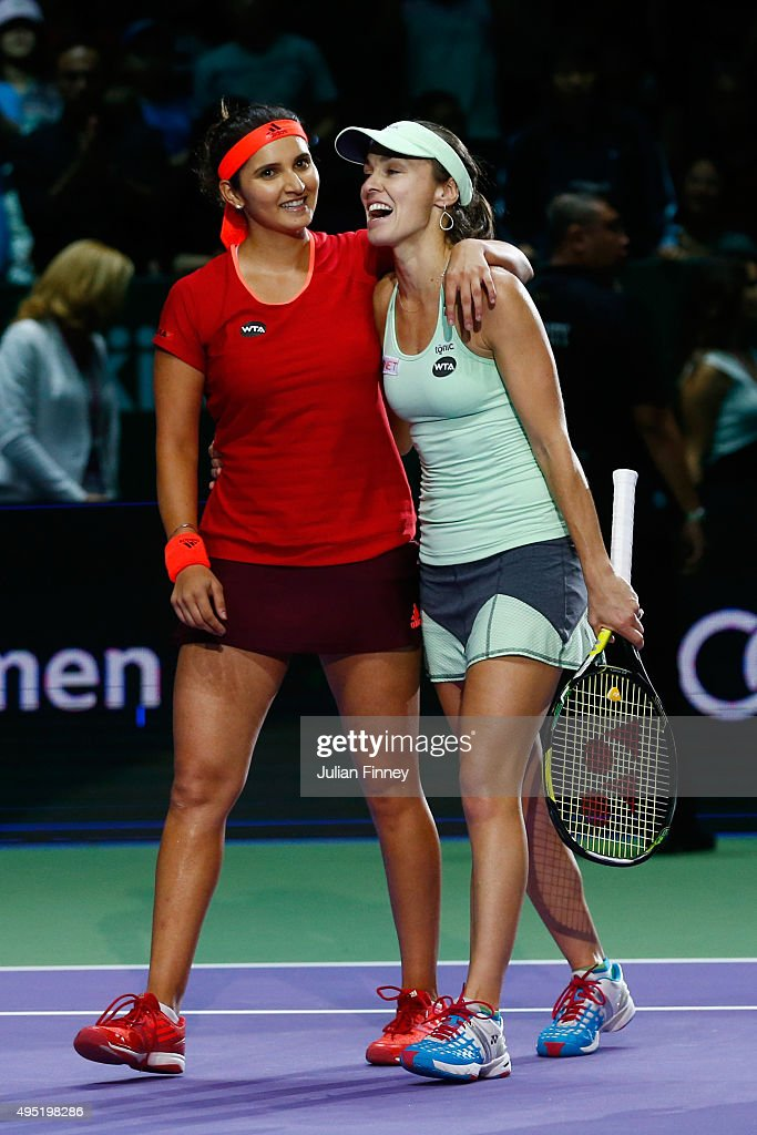 Sania Mirza of India and Martina Hingis of Switzerland celebrate defeating Carla Suarez Navarro and Garbine Muguruza of Spain in the doubles final match during the BNP Paribas WTA Finals at Singapore Sports Hub on November 1, 2015 in Singapore.