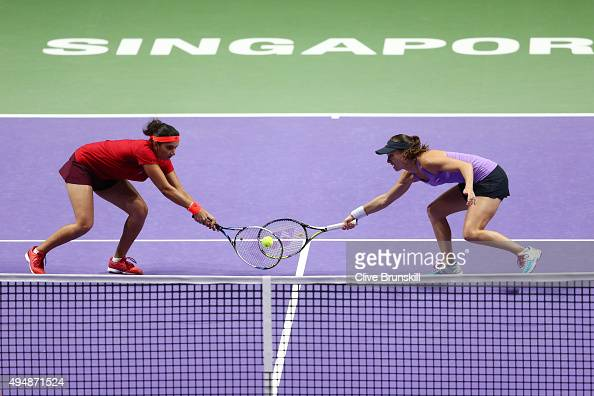Sania Mirza of India and Martina Hingis of Switzerland in action against Timea Babos of Hungary and Kristina Mladenovic of France during the BNP...
