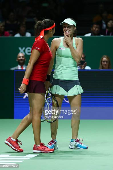 Sania Mirza of India and Martina Hingis of Switzerland in action during their doubles final match against Carla Suarez Navarro and Garbine Muguruza...