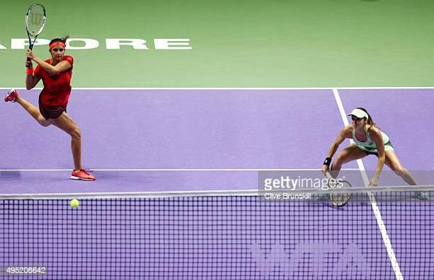 Sania Mirza of India and Martina Hingis of Switzerland in action during their doubles final match against Carla Suarez Navarro and Garbine Muguruza...