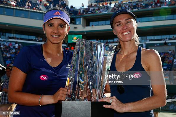 Sania Mirza of India and Martina Hingis of Switzerland with the winners trophies after defeating Ekaterina Makarova and Elena Vesnina of Russia...