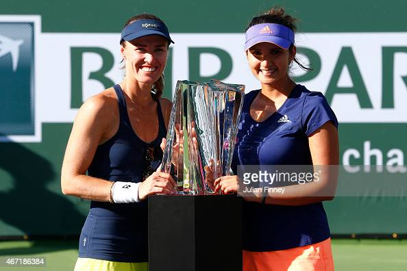 Sania Mirza of India and Martina Hingis of Switzerland with the winners trophies after defeating Ekaterina Makarova and Elena Vesnina of Russia in...