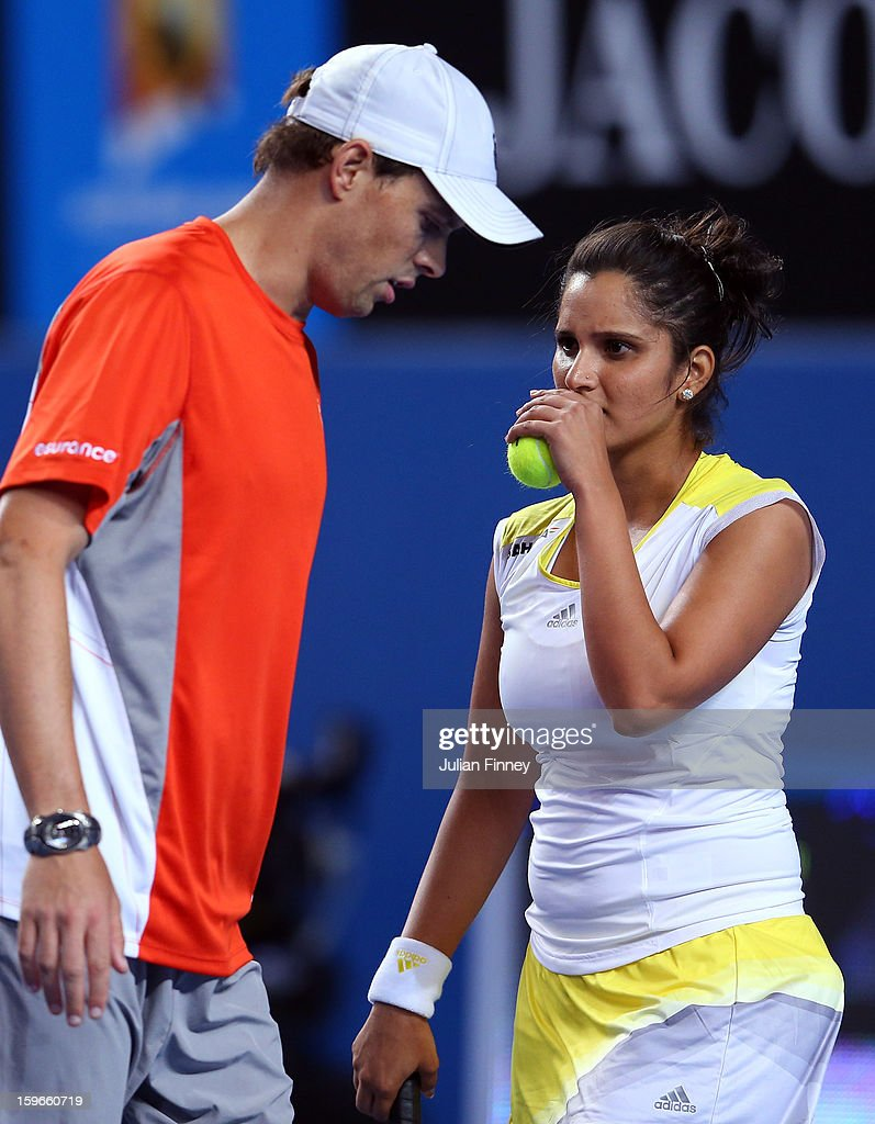 Sania Mirza of India in her mixed doubles match partnered with Bob Bryan of USA against Samantha Stosur and Luke Saville of Australia during day five of the 2013 Australian Open at Melbourne Park on January 18, 2013 in Melbourne, Australia.