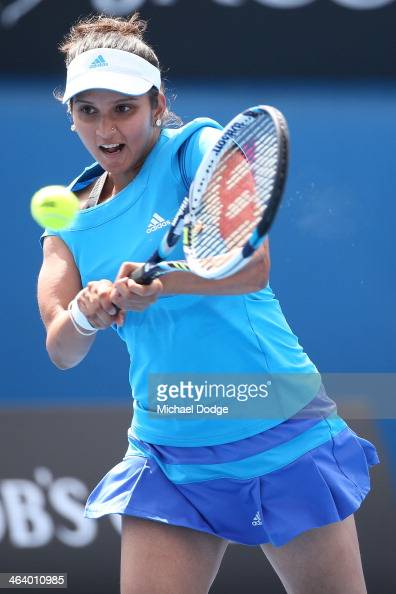 Sania Mirza of India plays a backhand in her third round doubles match with Cara Black of Zimbabwe against Eugenie Bouchard of Canada and Vera...