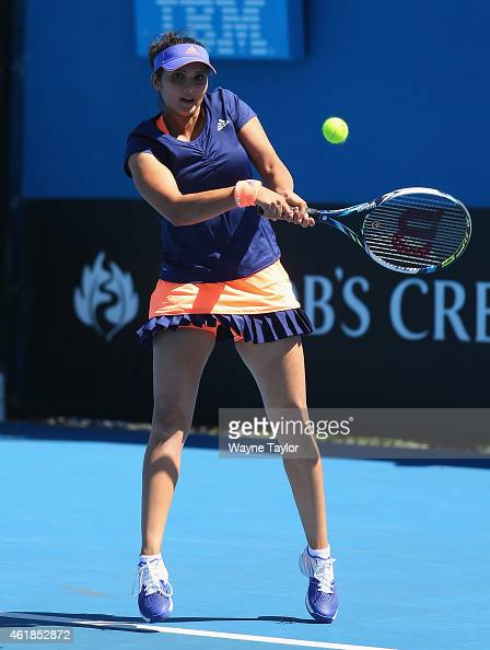 Sania Mirza of India plays a backhand in their first round doubles match with SuWei Hsieh of Chinese Taipei against Maria Irigoyen of Argentina and...