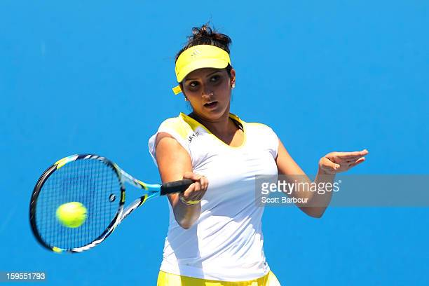 Sania Mirza of India plays a forehand in her first round doubles match with Bethanie MattekSands of the United States against Silvia SolerEspinosa of...