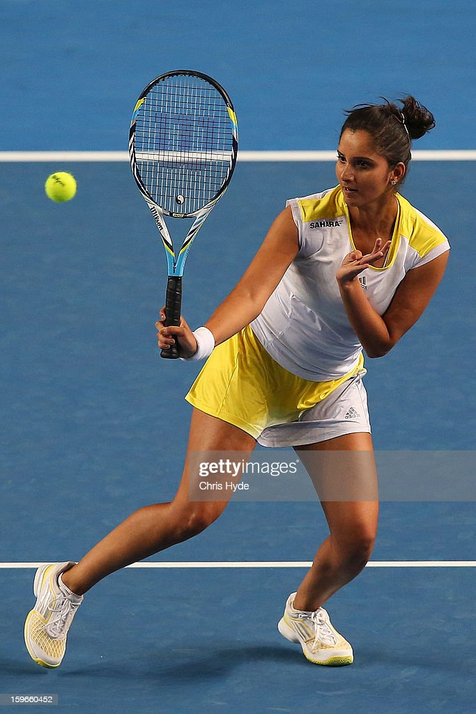 Sania Mirza of India plays a forehand in her mixed doubles match partnered with Bob Bryan of USA against Samantha Stosur and Luke Saville of Australia during day five of the 2013 Australian Open at Melbourne Park on January 18, 2013 in Melbourne, Australia.