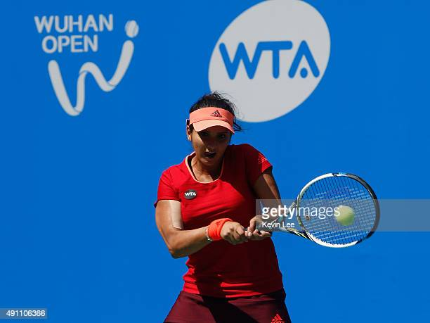 Sania Mirza of India returns a shot to IrinaCamelia Begu of Romania and Monica Niculescu of Romania during their match on day 7 of 2015 Dongfeng...
