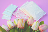 Sanitary napkins, pad (sanitary towel, sanitary pad, menstrual pad) on pink background.