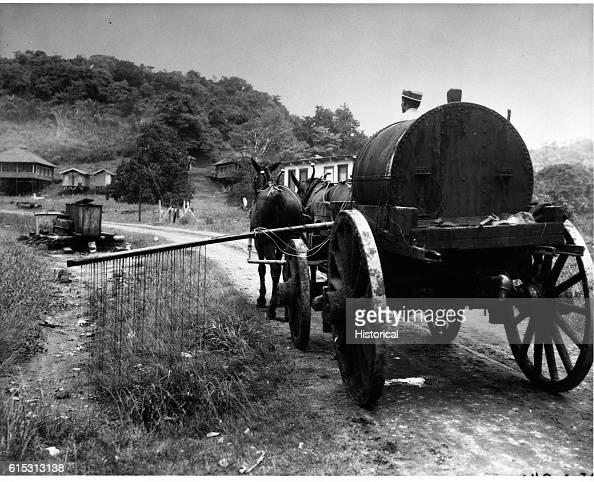 Sanitation Spraying oil from horsedrawn tank wagon March 26 1932