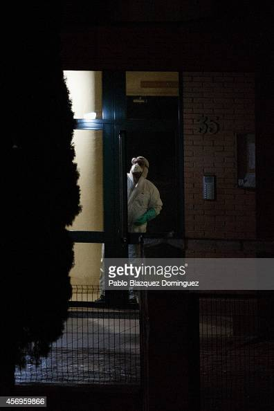 A sanitation worker wearing protective clothing desinfects the stairs of the apartment building the private residence for Spanish nurse Teresa Romero...