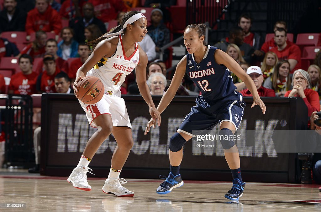Saniya Chong #12 of the Connecticut Huskies defends against Lexie Brown #4 of the Maryland Terrapins at the Comcast Center on November 15, 2013 in College Park, Maryland.