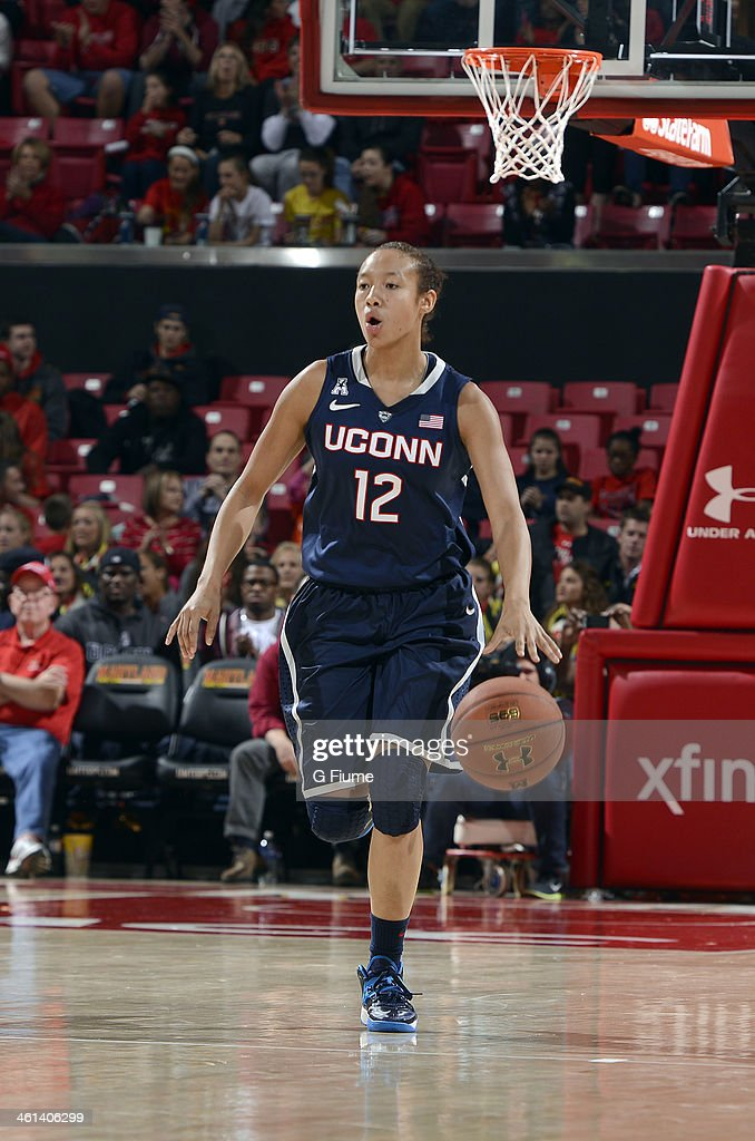 Saniya Chong #12 of the Connecticut Huskies handles the ball against the Maryland Terrapins at the Comcast Center on November 15, 2013 in College Park, Maryland.