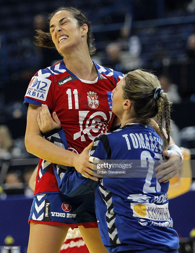 Sanja Damjanovic (L) celebrates a score with goalkeeper Katarina Tomasevic (R) of Serbia during the Women's European Handball Championship 2012 Group I main round match between Serbia and Denmark at Arena Hall on December 11, 2012 in Belgrade, Serbia.