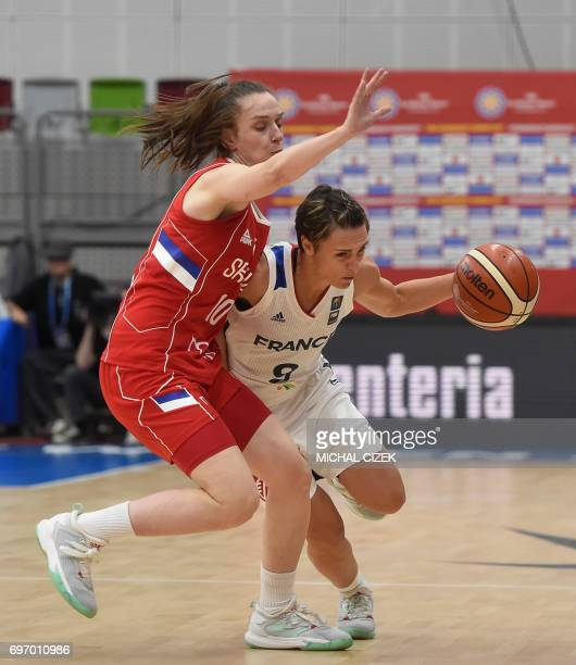 Sanja Mandic of Serbia vies for the ball with France's Celine Dumerc during the FIBA EuroBasket women's basketball match France v Serbia on June 17...