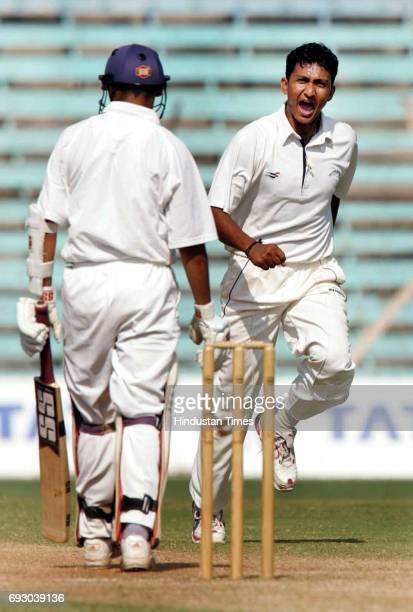 Sanjay Bangar of Railway celebrates after claiming Mumbai's Vinit Indulkar wicket in their elite division Ranji Cricket match at Wankhede Stadium on...