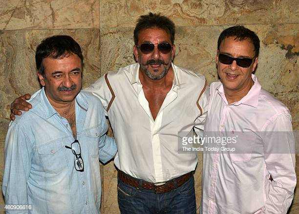Sanjay Dutt Vidhu Vinod Chopra and Raju Hirani at the special screening of film PK in Mumbai