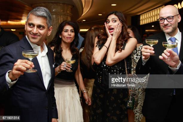 Sanjay Kapoor Executive Chairman Deepika Gehani and actress Athiya Shetty during the launch of iconic New York design label 'Coach' store at DLF...