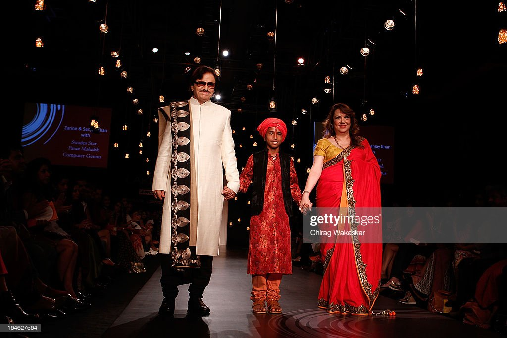 Sanjay Khan, Pavan Mahadik & <a gi-track='captionPersonalityLinkClicked' href=/galleries/search?phrase=Zarine+Khan&family=editorial&specificpeople=6381777 ng-click='$event.stopPropagation()'>Zarine Khan</a> showcase designs by Vikram Phadnis on the runway during day four of Lakme Fashion Week Summer/Resort 2013 on March 25, 2013 at Grand Hyatt in Mumbai, India.