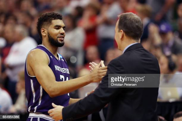 Sanjay Lumpkin and head coach Chris Collins of the Northwestern Wildcats shake hands as he is substituted out late in the game in their loss to the...