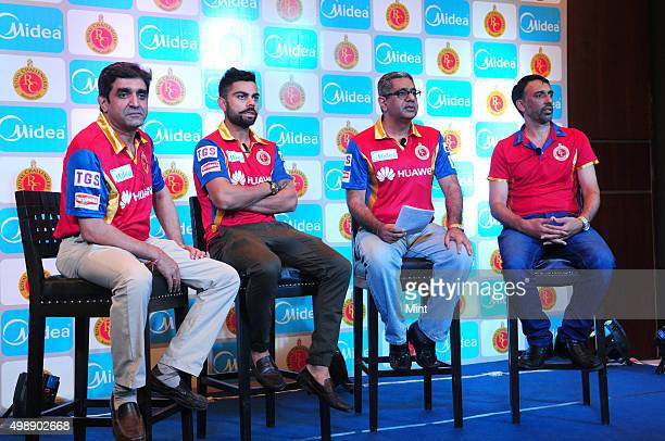 Sanjay Mahajan VP Sales and Marketing Carrier Midea India Virat Kohli player of Royal Challengers Bangalore Krishan Sachdev MD Carrier Midea india...