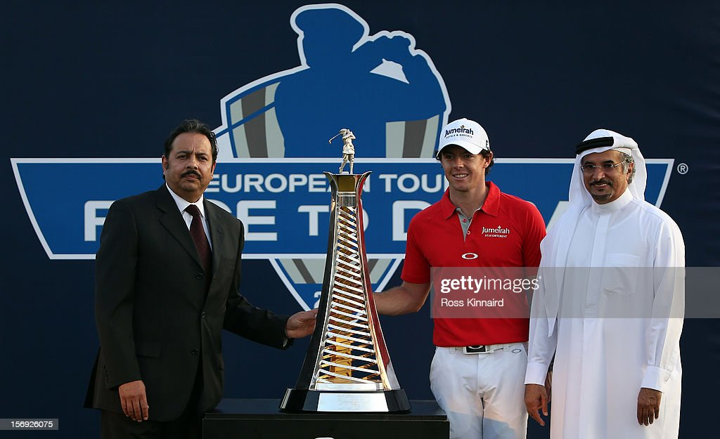 Sanjay Manchanda CEO Nakheel and Saeed Hareb Managing Director, Nakheel Marine and Leisure, Chairman of the Championship Committe present Rory McIlroy of Northern Ireland (centre) with the Race to Dubai trophy after the final round the DP World Tour Championship on the Earth Course at Jumeirah Golf Estates on November 25, 2012 in Dubai, United Arab Emirates.