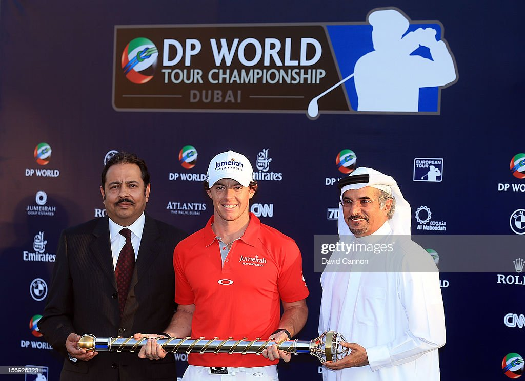 Sanjay Manchanda (left) CEO Nakheel and Saeed Hareb (right) Managing Director, Nakheel Marine and Leisure, Chairman of the Championship Committe present Rory McIlroy of Northern Ireland (centre) with the DP World Tour Championship Trophy after his win during the final round of the 2012 DP World Tour Championship on the Earth Course at Jumeirah Golf Estates on November 25, 2012 in Dubai, United Arab Emirates.