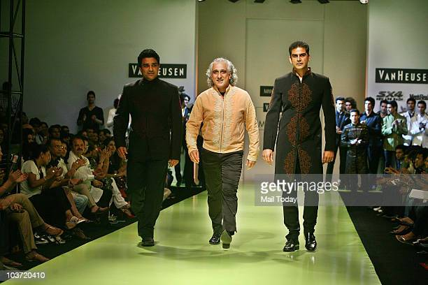 Sanjay Manjrekar and Nikhil Chopra walk the ramp for designer Manoviraj Khosla at the India Mens Week in New Delhi on August 28 2010