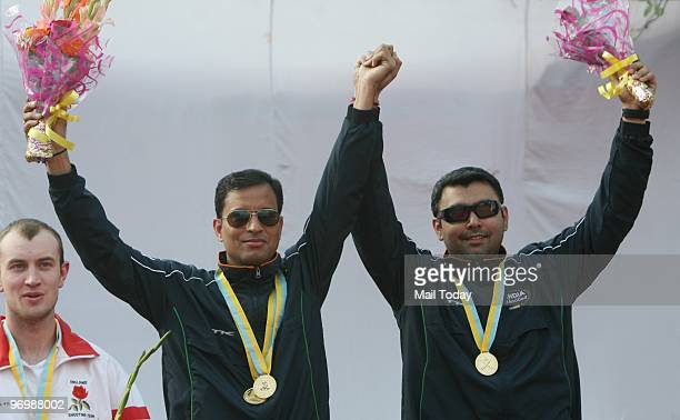 Sanjeev Rajput and Gagan Narang winners of the 50m rifle 3 position team gold pose at the Commonwealth Shooting Championship in New Delhi on February...
