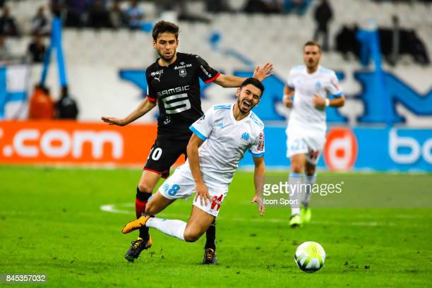 Sanjin Prcic of Rennes and Morgan Saison of Marseille during the Ligue 1 match between Olympique Marseille and Stade Rennais at Stade Velodrome on...