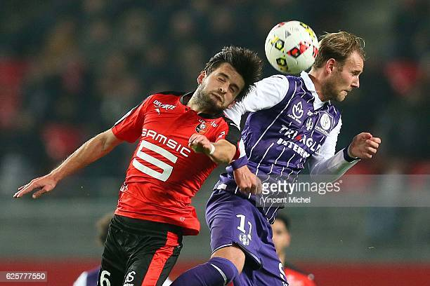 Sanjin Prcic of Rennes and Nils Ola Toivonen of Toulouse during the French Ligue 1 match between Rennes and Toulouse at Roazhon Park on November 25...
