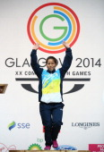 Sanjita Chanu Khumukcham of India celebrates winning the Gold Medal in the Women's 48kg Weightlifting at the Scottish Exhibition And Conference...