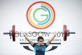 Sanjita Chanu Khumukcham of India competes in the Snatch on her way to winning the Gold Medal in the Women's 48kg Weightlifting at the Scottish...