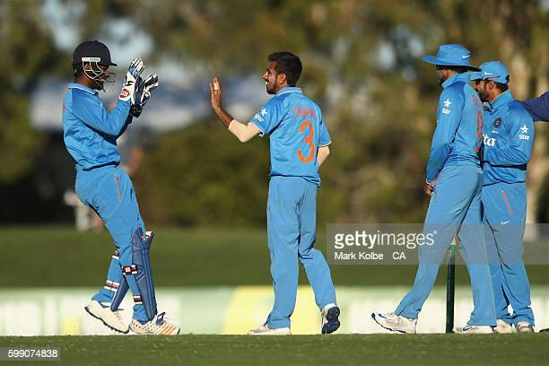 Sanju Samson of India congratulates Yuzvendra Chahal of India A after he took the wicket of Kane Richardson of Australia during the Cricket Australia...