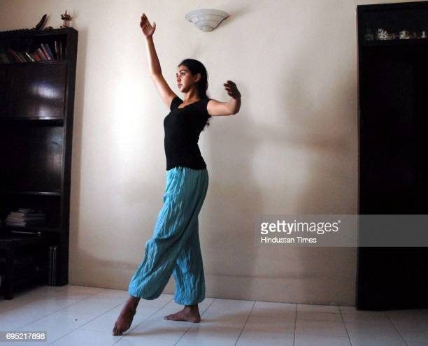 Sanjukta Wagh a Kathak Dancer warming up with Ballet Dance moves before her rehearsals Morning at her residence in Lamington Road Mumbai