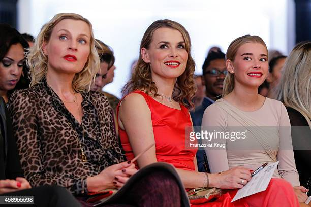 Sanna Englund Andrea Luedke and Milena Tscharntke attends the Audi Fashion Award 2014 on October 09 2014 in Hamburg Germany