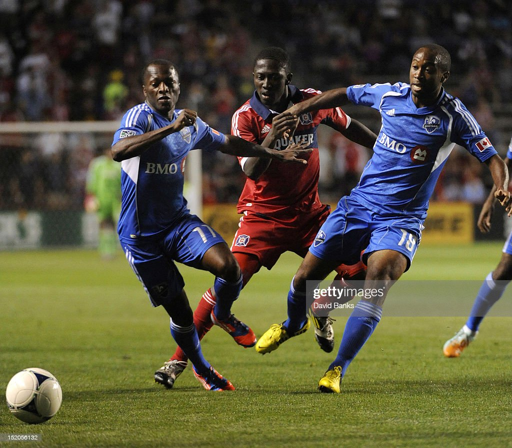 Sanna Nyassi #11 of Montreal Impact and Collen Warner #18 go for the ball with <a gi-track='captionPersonalityLinkClicked' href=/galleries/search?phrase=Patrick+Nyarko&family=editorial&specificpeople=4824163 ng-click='$event.stopPropagation()'>Patrick Nyarko</a> #14 of Chicago Fire in an MLS match on September 15, 2012 at Toyota Park in Bridgeview, Illinois.