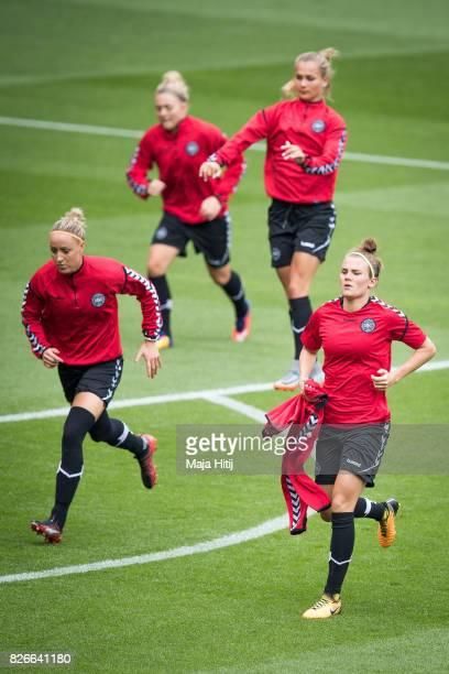 Sanne Troelsgaard and Katrine Veje of Denmark warm up during a training prior UEFA Women's Euro 2017 Final against Netherlands at De Grolsch Veste...