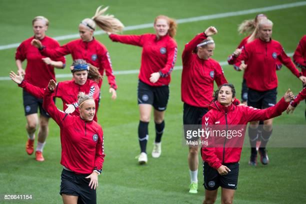 Sanne Troelsgaard and Nadia Nadim of warm up during a training prior UEFA Women's Euro 2017 Final against Netherlands at De Grolsch Veste Stadium on...