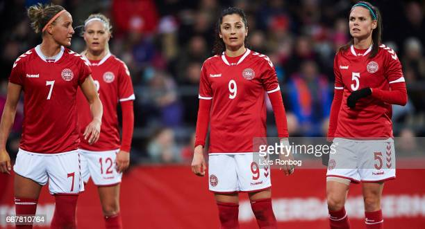 Sanne Troelsgaard Stine Larsen Nadia Nadim and Simone Boye Sorensen of Denmark looks on during the international friendly match between Denmark women...