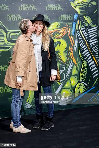 Sanny van Heteren and her sister Jessica van Heteren attend the 'Teenage Mutant Ninja Turtles' Premiere on October 05 2014 in Berlin Germany