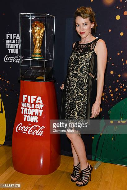 Sanny van Heteren poses with the trophy at the Gala Night of the FIFA World Cup Trophy Tour on March 29 2014 in Berlin Germany