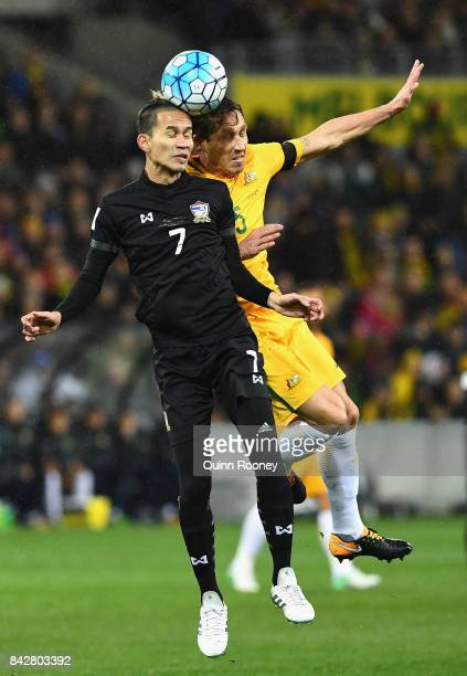 Sanrawat Dechmitr of Thailand and Mark Milligan of Australia compete to head the ball during the 2018 FIFA World Cup Qualifier match between the...