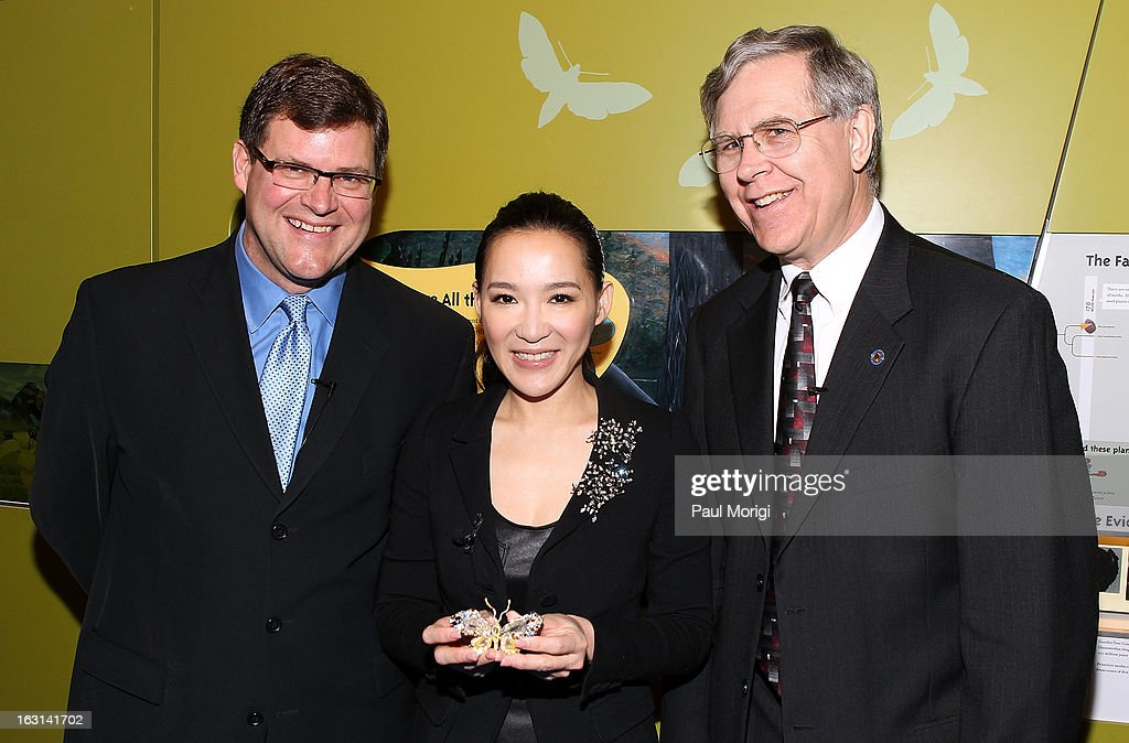 Sant Director of the National Museum of Natural History Kirk Johnson, jewelry artist Cindy Chao and Jeffrey Post, Curator, National Gems and Minerals Collection, Smithsonian's National Museum of Natural History, pose for a photo during the ceremony to accession Chao's Black Label Masterpiece Royal Butterfly Brooch into the Smithsonian's National Museum of Natural History on March 5, 2013 in Washington, DC.