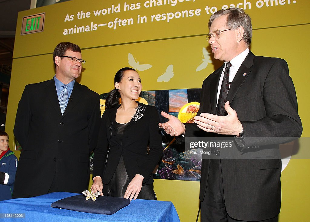 Sant Director of the National Museum of Natural History Kirk Johnson (L) listens as Jeffrey Post, Curator, National Gems and Minerals Collection, Smithsonian's National Museum of Natural History, makes a few remarks at the unveiling of jewelry artist Cindy Chao's Black Label Masterpiece Royal Butterfly Brooch to be accessioned into the Smithsonian's National Museum of Natural History on March 5, 2013 in Washington, DC.